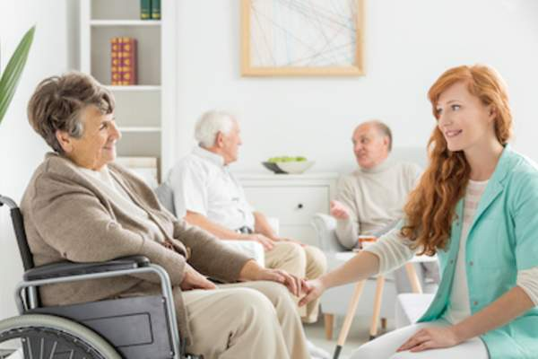 Staff member talking with client in adult day care facility