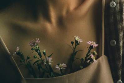 close up of woman's chest with flowers in shirt