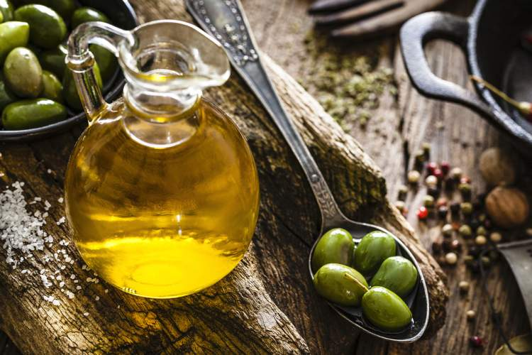 Flask of olive oil and olives.