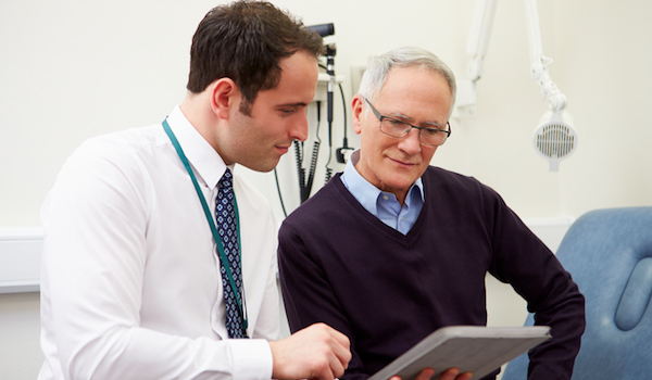 Man discussing erectile dysfunction treatments with doctor