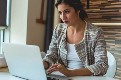 Young woman on laptop in home office image.