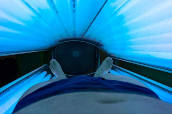 Man in Phototherapy bed.