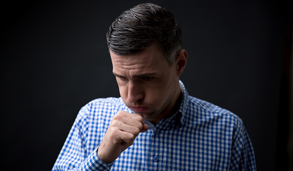 man coughing image