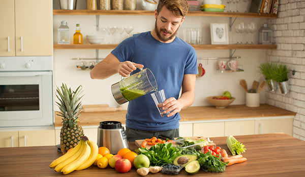 man juicing fruits and vegetables image
