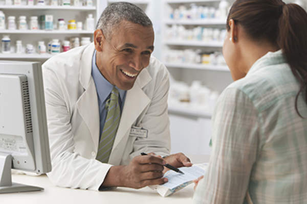 Woman talking to her pharmacist.