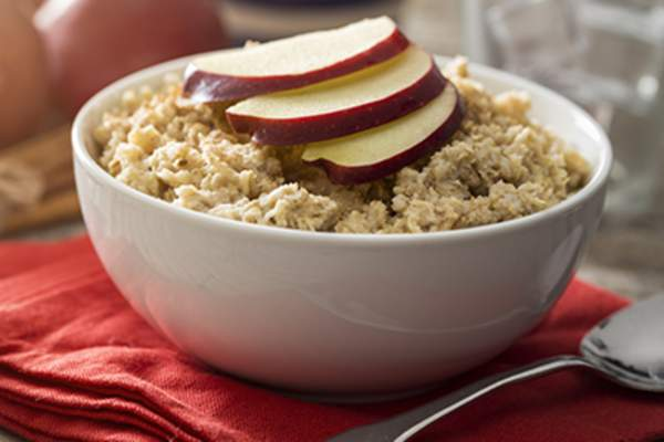 Oatmeal with sliced apples.