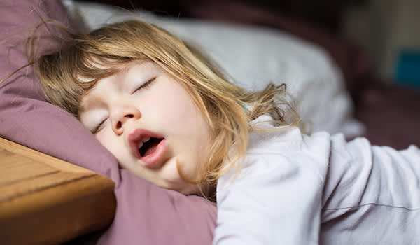 Child snoring in bed