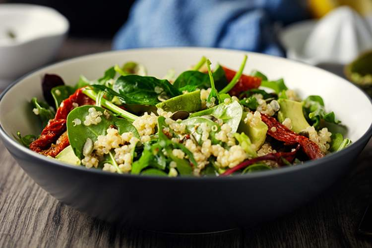 Quinoa salad with avocado and spinach.