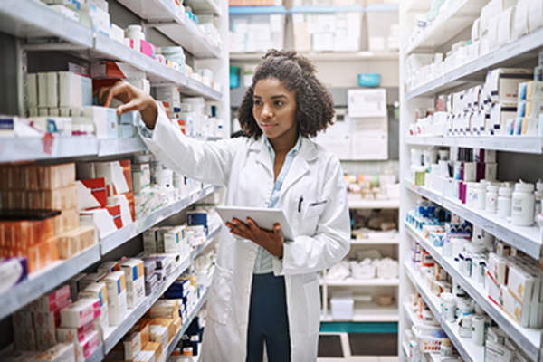 Pharmacist selecting medication.