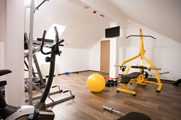 Private gym in the attic of modern house