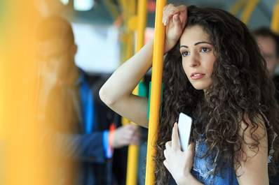 Distressed woman on a bus.