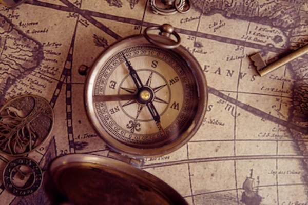 Compass on map, navigation concept.