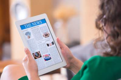 Woman reading news on tablet.