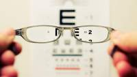glasses and blurry eye chart
