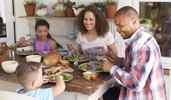 family having dinner at the table image