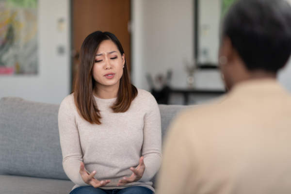 woman talking in therapy session
