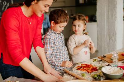 Children helping their mother with rheumatoid arthritis make dinner.