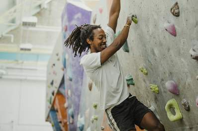 Man climbing a rock wall.