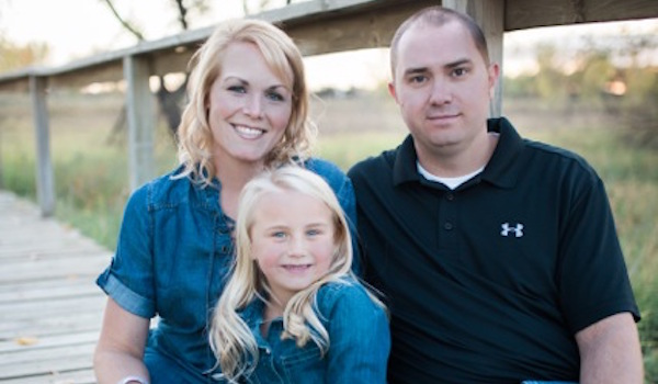 Heather Huus with husband, Sean, and daughter, Paige.