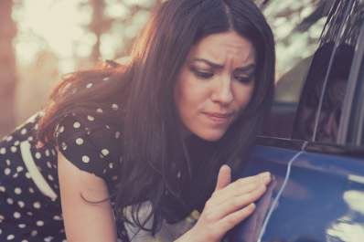 Woman stressing over car not being perfectly clean.
