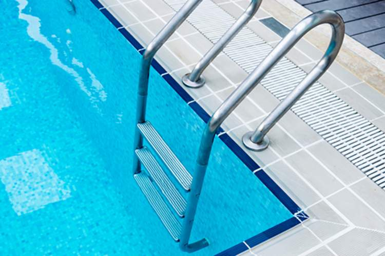 Swimming pool ladder.