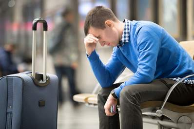 stressed man in airport image
