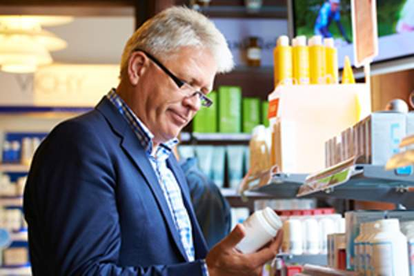man buying supplements image