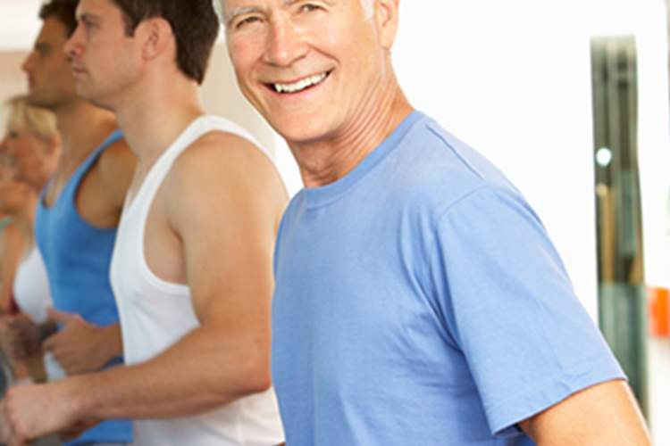 older man exercising on treadmill image