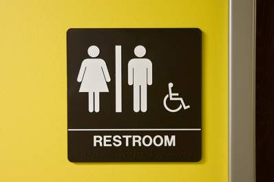 Restroom access sign.