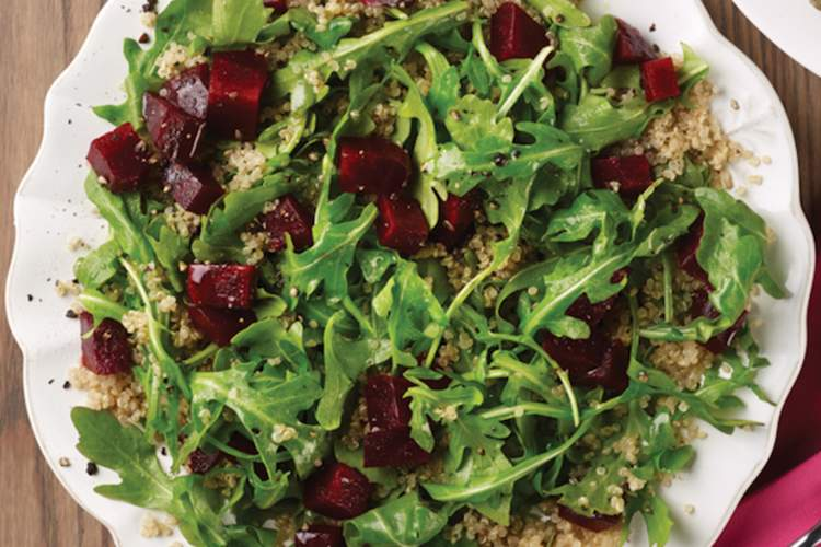 Beet, quinoa, and arugula salad is a balanced meal for a diabetes diet.