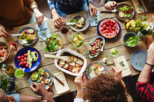 Group of people eating a healthy meal.
