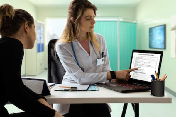 Doctor and patient reviewing online care plan.