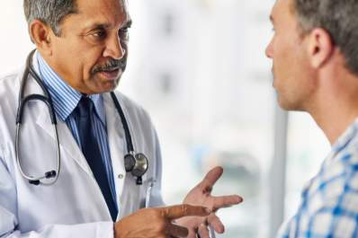 Doctor explaining to male patient