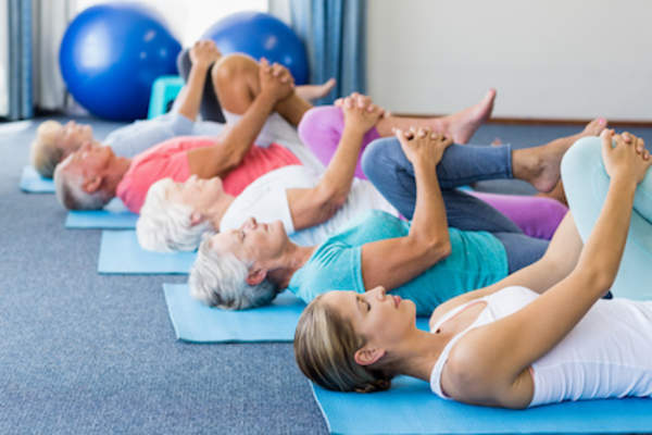Flexibility exercise, yoga class for seniors.