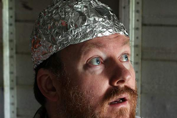 Conspiracy theorist wearing a tin foil hat.