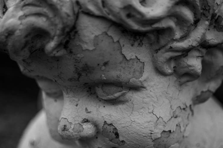 close up of peeling statue