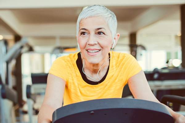 Woman on exercise bike at the gym image.