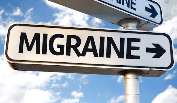 Migraine street sign with arrow.