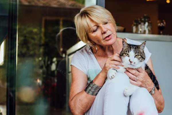 mature woman and her cat