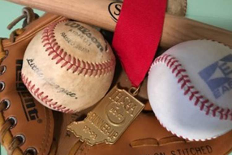 Baseballs, a baseball bat, and a medal.
