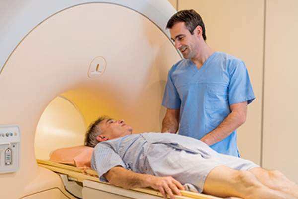Radiologist talking to a mature patient at MRI scan