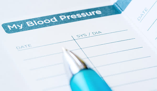 Blood pressure log and pen.