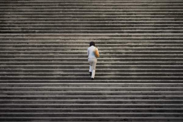 Woman climbing big flight of stairs