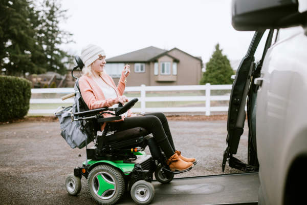 young woman in power wheelchair