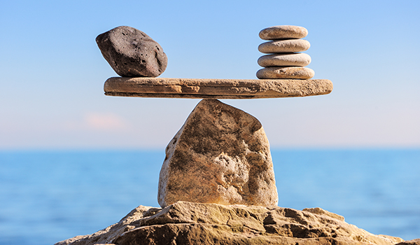 Balance concept with rocks on the beach.