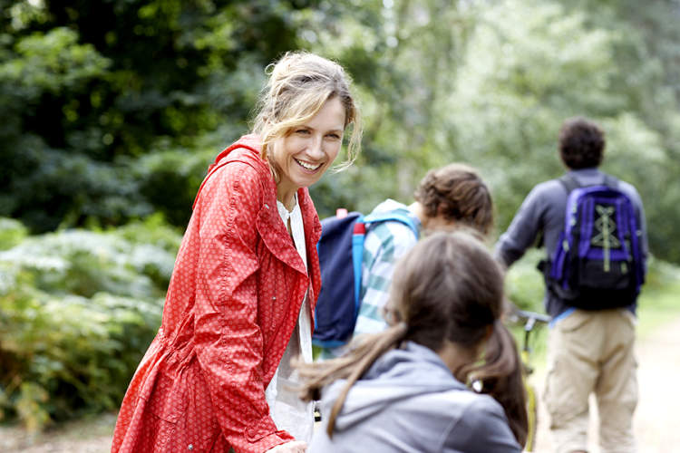 Woman on a walk with children
