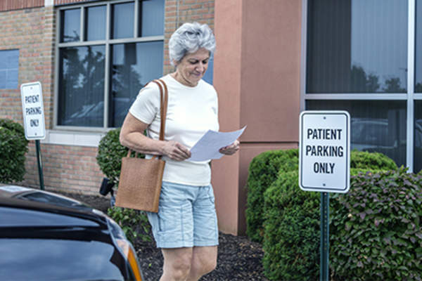 Woman leaving a doctor appointment.