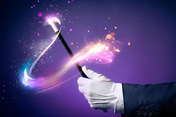 Magician waving a magic wand.
