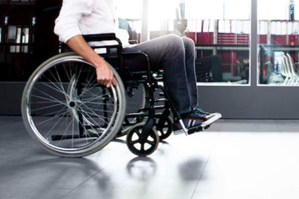 wheelchair rolling through airport.