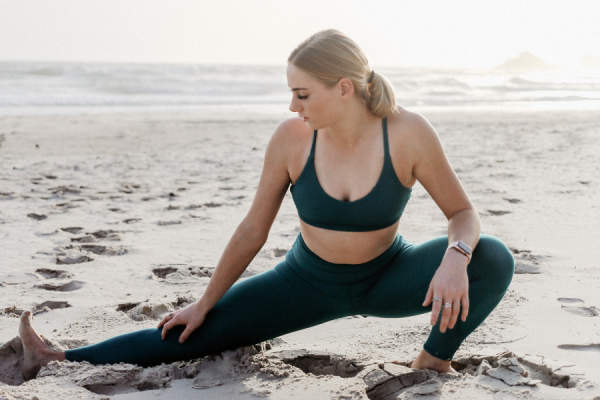 woman stretching on beach
